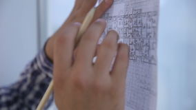 Unrecognizable architects hands working with sketch, drawing, plan near bright clean office panoramic window. stock footage