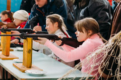 Unrecognizable Belarusian secondary school pupils girls shooting Royalty Free Stock Photo