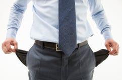 Unrecognizable biznesmen demonstruje jego puste kieszenie Obraz Stock