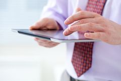 Male hands touching digital tablet Stock Images