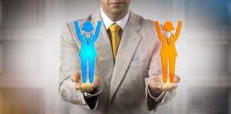 Man Balancing Two Cheering Female Employee Icons. Unrecognizable business manager keeping two cheering female employee icons in balance. Concept for mediation Royalty Free Stock Photo