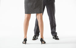 Unrecognizable business people's legs in conflicting pose Stock Photo