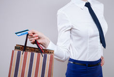 Unrecognizable business woman  holding shopping bags and plastic Royalty Free Stock Photos