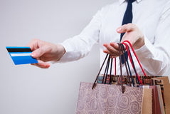 Unrecognizable business woman  holding shopping bags and plastic Royalty Free Stock Images