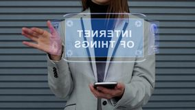 Business woman interacts HUD hologram Internet of things. Unrecognizable business woman, interacts with a HUD hologram text Internet of things. Girl in a stock footage