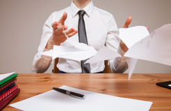 Unrecognizable business woman throwing disrupt documents Royalty Free Stock Photography