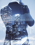 Economy concept. Unrecognizable businessman on abstract city background with business chart. Economy concept. Double exposure stock images