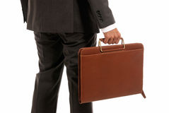Unrecognizable businessman back suitcase isolated. Unrecognizable businessman back with suitcase isolated on white background Stock Images