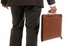 Unrecognizable businessman back suitcase isolated. Unrecognizable businessman back with suitcase isolated on white background stock image