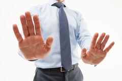 Unrecognizable businessman  demonstrating a gesture of a rejecti. On, white background Royalty Free Stock Image