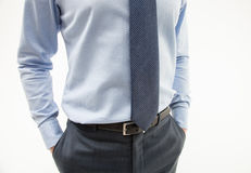 Unrecognizable businessman hiding his hands in pockets Stock Photo