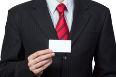 Unrecognizable businessman holding a card in hand Stock Images