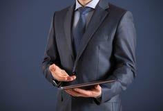 Unrecognizable businessman holding documents and explaining some Stock Photo