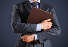 Unrecognizable businessman holding folders with documents Stock Image