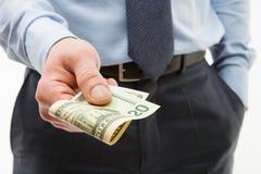 Unrecognizable businessman holding twenty dollars Stock Photography