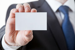 Unrecognizable businessman holding a visiting card Royalty Free Stock Image