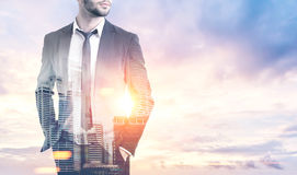 Unrecognizable businessman in a morning city Royalty Free Stock Photos