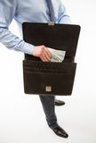Unrecognizable businessman puts money in a briefcase Stock Photos