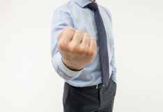 Unrecognizable businessman showing a strong fist. White background Royalty Free Stock Photos