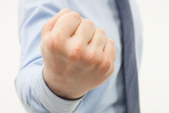 Unrecognizable businessman showing a strong fist. White background Stock Photo