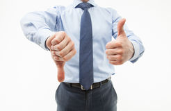 Unrecognizable businessman showing thumb down and thumb up Royalty Free Stock Photo