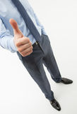 Unrecognizable businessman showing thumb up. White background Royalty Free Stock Photo