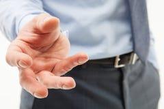Unrecognizable businessman showing an unpleasant demanding gestu. Re, white background Royalty Free Stock Image
