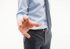 Unrecognizable businessman showing an unpleasant demanding gestu. Re, white background Royalty Free Stock Images