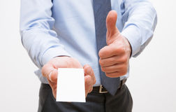 Unrecognizable businessman showing  visiting and thumb up sign Royalty Free Stock Images