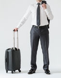 Unrecognizable businessman with a suitcase Royalty Free Stock Image