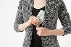 Unrecognizable businesswoman hiding money Stock Photography