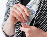 Unrecognizable businesswoman hiding money Stock Images