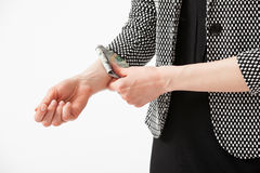 Unrecognizable businesswoman hiding money in the sleeve Royalty Free Stock Images