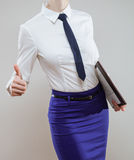Unrecognizable businesswoman holding documents and showing thumb Royalty Free Stock Photography