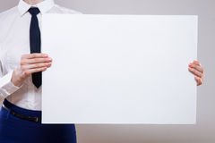 Unrecognizable businesswoman holding an empty placard Royalty Free Stock Images