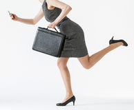 Free Unrecognizable Businesswoman Running And Holding Her Cellphone A Stock Photography - 56539272