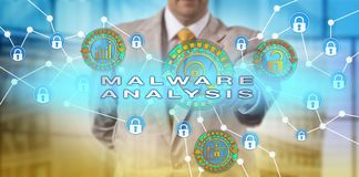 Incident Manager Performing Malware Analysis. Unrecognizable computer security incident manager investigating malicious software attack perpetrated on portable Stock Photography