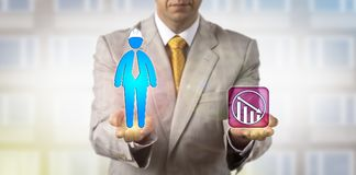 Equating Male Construction Worker With Downturn. Unrecognizable corporate officer equating negative growth trend arrow with a male construction worker icon Royalty Free Stock Photos