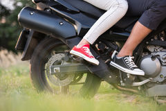 Unrecognizable couple enjoying a motorbike ride in countryside. Royalty Free Stock Photography