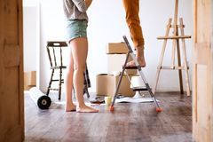 Unrecognizable couple moving in new house. Royalty Free Stock Photography