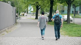 Unrecognizable couple walk along the street in Berlin. Unrecognizable couple walk along the street stock footage