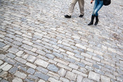 Couple on cobblestones Royalty Free Stock Image