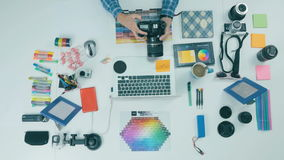 Unrecognizable creative designer working in a creative agency. Top view. 4K stock video