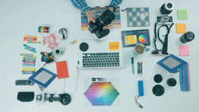 Unrecognizable creative photographer working at his workplace. Top view. stock video