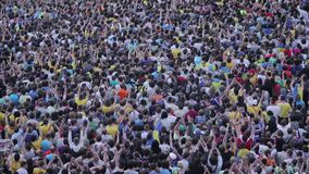 Unrecognizable crowd of people watching event (football, soccer fans, concert) stock video