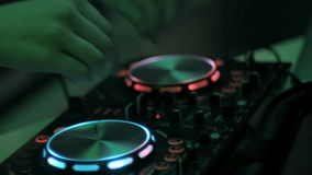 Unrecognizable Dj hands playing music at the nightclub. Mixing console. Close up. stock video footage