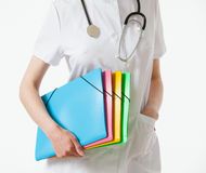 Unrecognizable doctor holding several folders Stock Photography