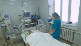 Unrecognizable doctor Resuscitating Elderly Patient in intensive care unit. stock video