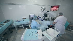 Unrecognizable Doctors team performing surgery in hospital operating room. stock footage