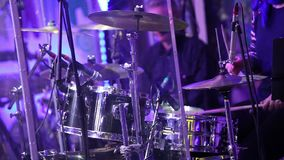 An unrecognizable drummer , a man playing drums, a drummer in a music band, a live performance. Anonymous Drummer. Anonymous Drummer Drumming on Stage - Close Up stock footage